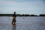 Elder fisherman taking a break