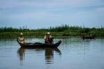 Two elder fishermen squatting and waiting