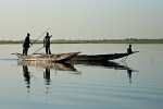 Pirogue drivers discussing directions on the Niger river near ferry crossing to Timbuktu, Mali. Photo by Marko Preslenkov.