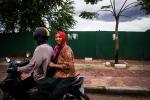Grandma riding the scooter sideways