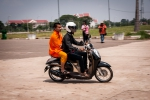 Lao Buddhist monk on a scooter