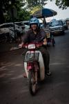 Lao currier on his Honda motorbike