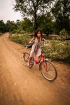 Wee Lao girl racing her red bicycle
