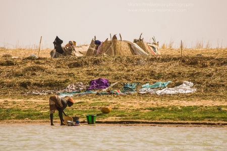 Washing dishes in Niger river