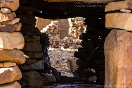 Elder man resting in Anakanda village