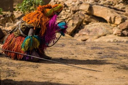 Traditional Dogon mask kneeling