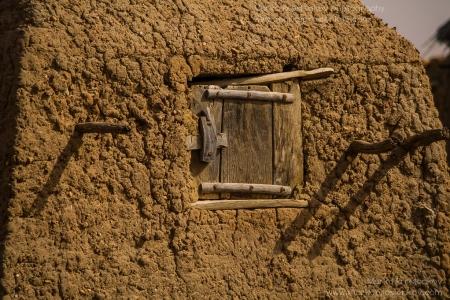 Wooden window shutter in Anakanda village