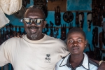 Shop owner and his son