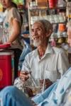 Elder man enjoying afternoon jasmine tea