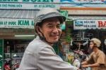 Man happily posing on his motorbike
