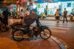 Watching the night from his Magie S motorbike