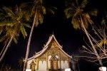 Wat Haw Pha Bang between the palm trees