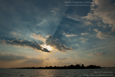 Sun rays over Mekong river island