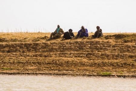 Elders observing the river