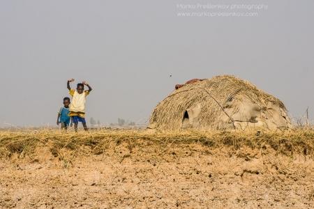 Kids next to a hut