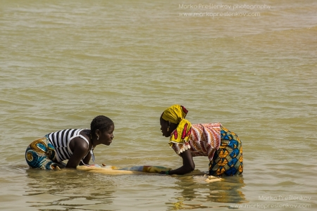 Two girls washing clothes
